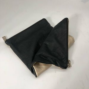 Reversible vegan leather clutch carryall